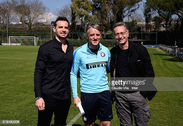 Carlo Molfetta head coach FC Internazionale Roberto Mancini and Paolo Bonolis pose for a photo prior to the Serie A match between AS Roma and FC...