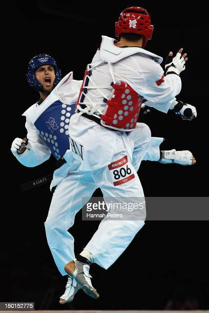 Carlo Molfetta of Italy competes against Xiaobo Liu of China during the Men's 80kg Taekwondo quarterfinal on Day 15 of the London 2012 Olympic Games...