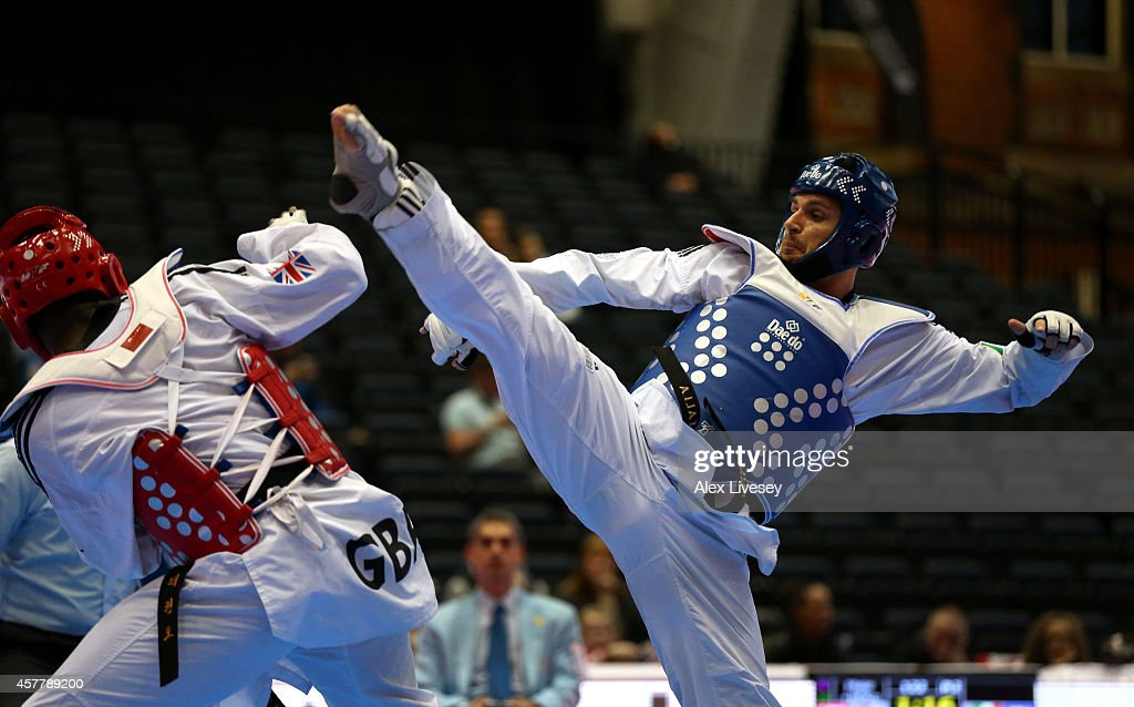Carlo Molfetta of Italy in action against Mahama Cho of Great Britain during the WTF World Taekwondo Grand Prix at Manchester Central on October 24...