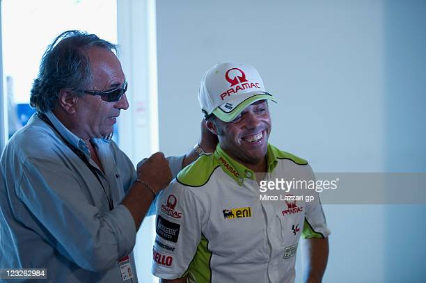 Carlo Pernat of Italy speaks with Loris Capirossi of Italy and Pramac Racing Team during the press conference preevent of MotoGP of San Marino at...