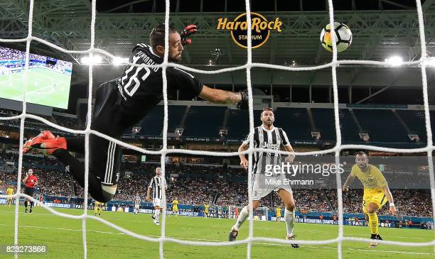 Carlo Pinsoglio of Juventus makes a save on Jese of Paris SaintGermain during the International Champions Cup 2017 match at Hard Rock Stadium on July...