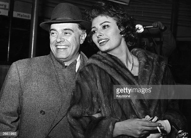 Carlo Ponti the Italian film director and his wife Sophia Loren the film actress arriving in Copenhagen en route from Rome to Los AngelesThey refused...