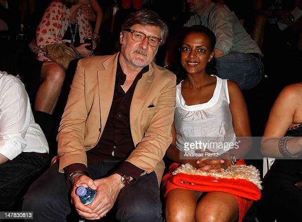 Carlo Rola and Dennenesch Zoude arrive for the Dawid Tomaszewski Show during the MercedesBenz Fashion Week Spring/Summer 2013 on July 4 2012 in...