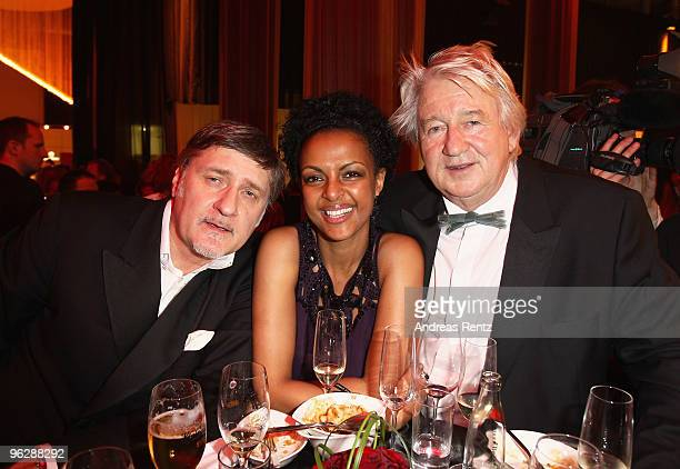 Carlo Rola with his wife Dennenesch Zoude and Wolfgang Gremm attend the after show party to Goldene Kamera 2010 Award at the Axel Springer Verlag on...