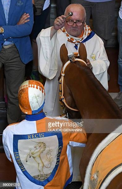 Carlo Sanna known as Brigante stands next to the horse called Remistrio as it receives the blessing at the San Giovannino della Staffa church in...