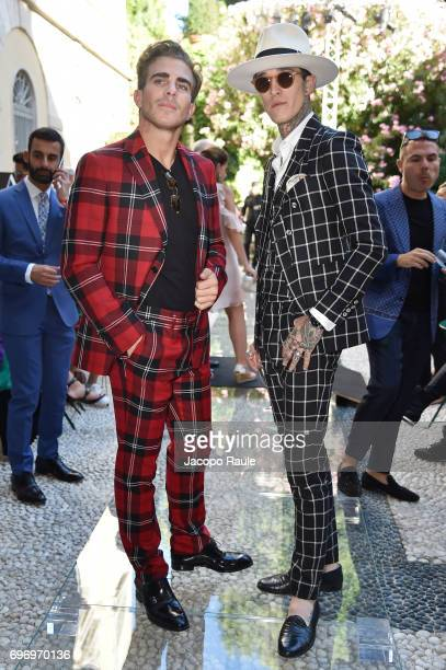 Carlo Sestini and James Edward Quaintance attend the Versace show during Milan Men's Fashion Week Spring/Summer 2018 on June 17 2017 in Milan Italy