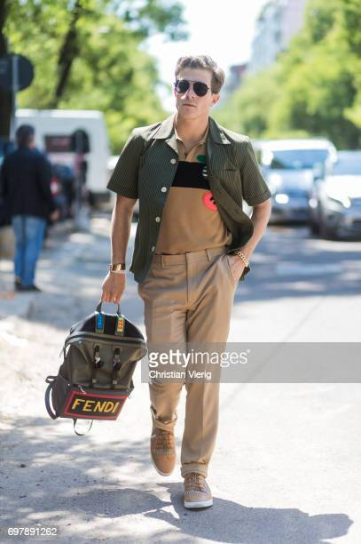 Carlo Sestini wearing polo shirt khaki pants olive shirt Fendi backpack is seen outside Fendi during Milan Men's Fashion Week Spring/Summer 2018 on...