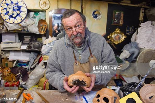 Carlo Settia traditional artisan works on a mask in his workshop on January 20 2012 in Venice Italy Traditional venetian mask makers are preparing...