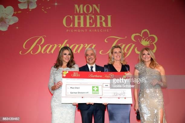 Carlo Vassallo Director Ferrero Germany Elizabeth 'Liz' Hurley and Dr Maria Furtwaengler and Frauke Ludowig with check during the Mon Cheri Barbara...