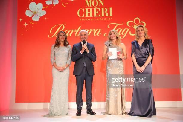 Carlo Vassallo Director Ferrero Germany Elizabeth 'Liz' Hurley Frauke Ludowig and Dr Maria Furtwaengler during the Mon Cheri Barbara Tag at...