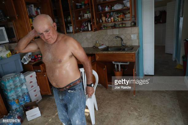 Carlo Zarlos Barrios walks through his home that was badly damaged by hurricane Irma on September 19 2017 in Marathon Florida The process of...
