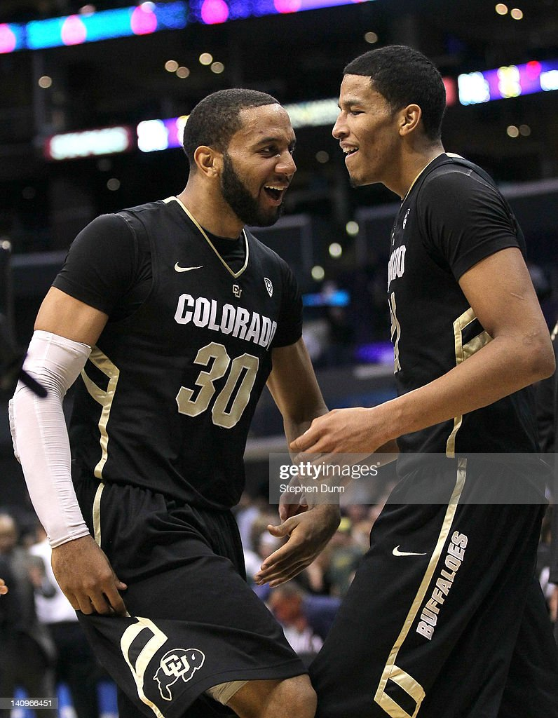 Carlon Brown #30 and Andre Roberson #21 of the Colorado Buffaloes celebrate after the game against the Oregon Ducks during the quarterfinals of the Pac12 Men's Basketball Tournament at Staples Center on March 8, 2012 in Los Angeles, California. Colorado won 63-62.