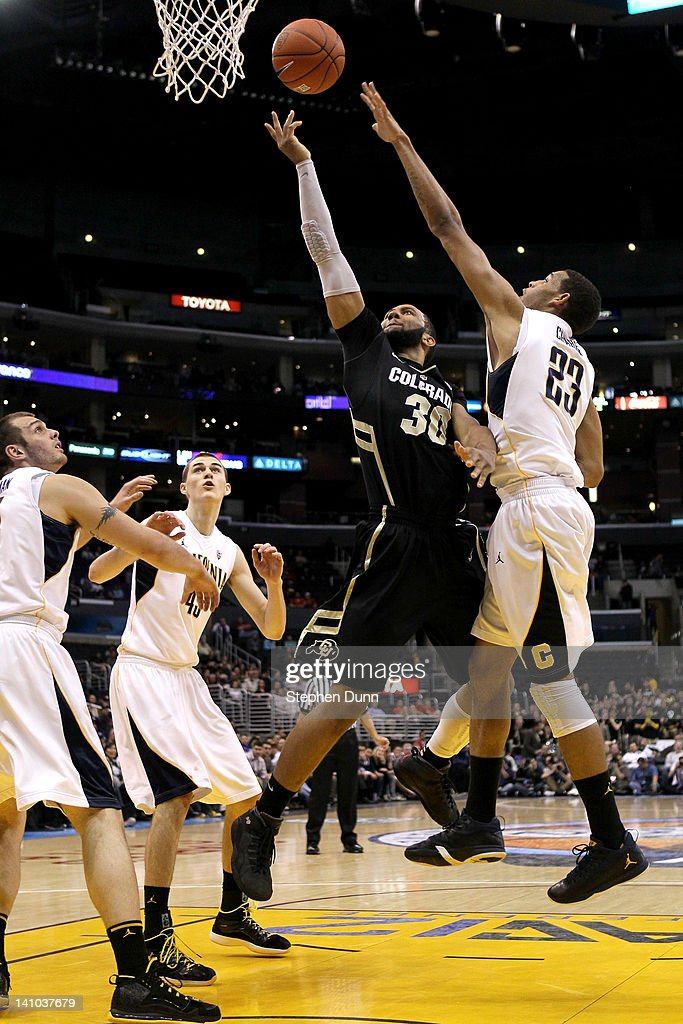 Carlon Brown #30 of the Colorado Buffaloes goes up for a shot over Allen Crabbe #23 of the California Golden Bears in the first half in the semifinals of the 2012 Pacific Life Pac-12 men's basketball tournament at Staples Center on March 9, 2012 in Los Angeles, California.