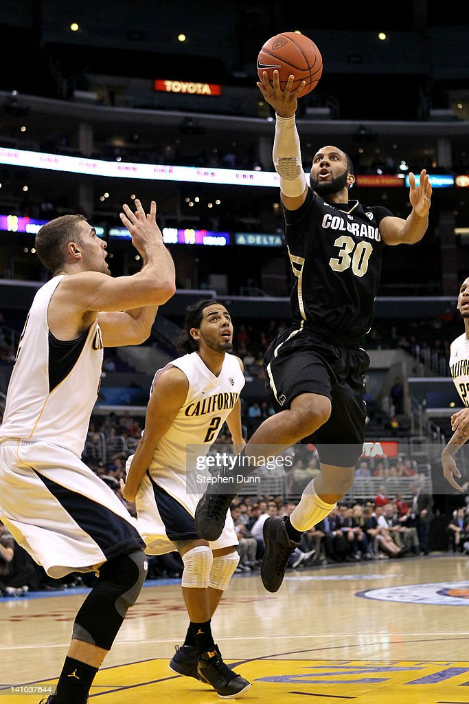 Carlon Brown #30 of the Colorado Buffaloes goes up for a shot over Harper Kamp #22 of the California Golden Bears in the first half in the semifinals of the 2012 Pacific Life Pac-12 men's basketball tournament at Staples Center on March 9, 2012 in Los Angeles, California.