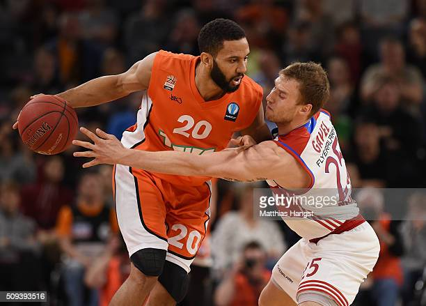 Carlon Brown of Ulm is challenged by Anton Gavel of FC Bayern Muenchen during the Eurocup Basketball match between ratiopharm Ulm and FC Bayern...