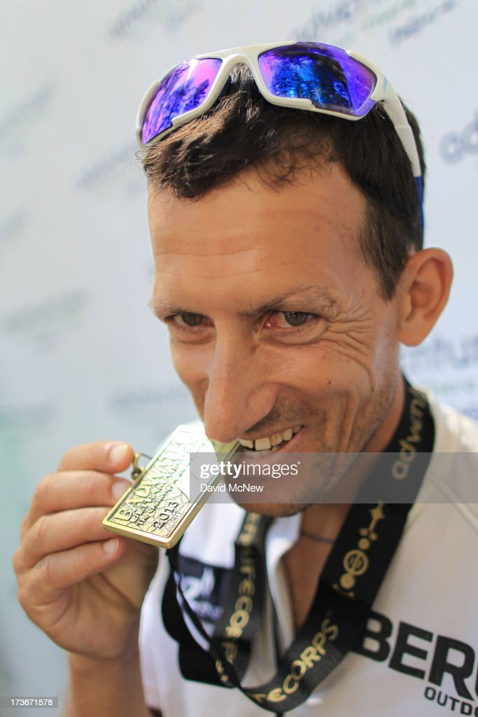 Carlos Alberto Gomas De Sa from Portugal, a first-time competitor in the event, bites his medal after winning the AdventurCORPS Badwater 135 ultra-marathon race on July 16, 2013 outside of Death Valley National Park, California. Billed as the toughest footrace in the world, the 36th annual Badwater 135 starts at Badwater Basin in Death Valley, 280 feet below sea level, where athletes begin a 135-mile non-stop run over three mountain ranges in extreme mid-summer desert heat to finish at 8,350 feet above sea level near Mount Whitney for a total cumulative vertical ascent of 13,000 feet. July 10 marked the 100-year anniversary of the all-time hottest world record temperature of 134 degrees, set in Death Valley where the average high in July is 116. A total of 96 competitors from 22 nations attempted the run which equals about five back-to-back marathons. Previous winners have completed all 135 miles in less than 24 hours.