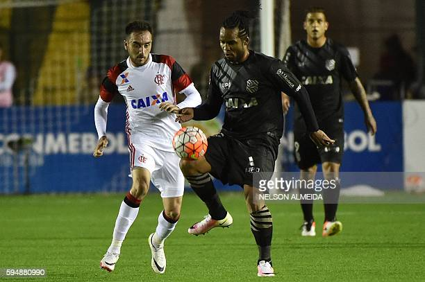 Carlos Alberto of Brazil's Figueirense vies for the ball with Federico Mancuello of Brazil's Flamengo during their 2016 Copa Sudamericana football...
