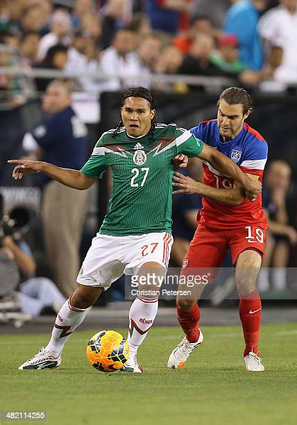 Carlos Alberto Pena of Mexico controls the ball ahead of Graham Zusi of USA during the first half of the International Friendly at University of...