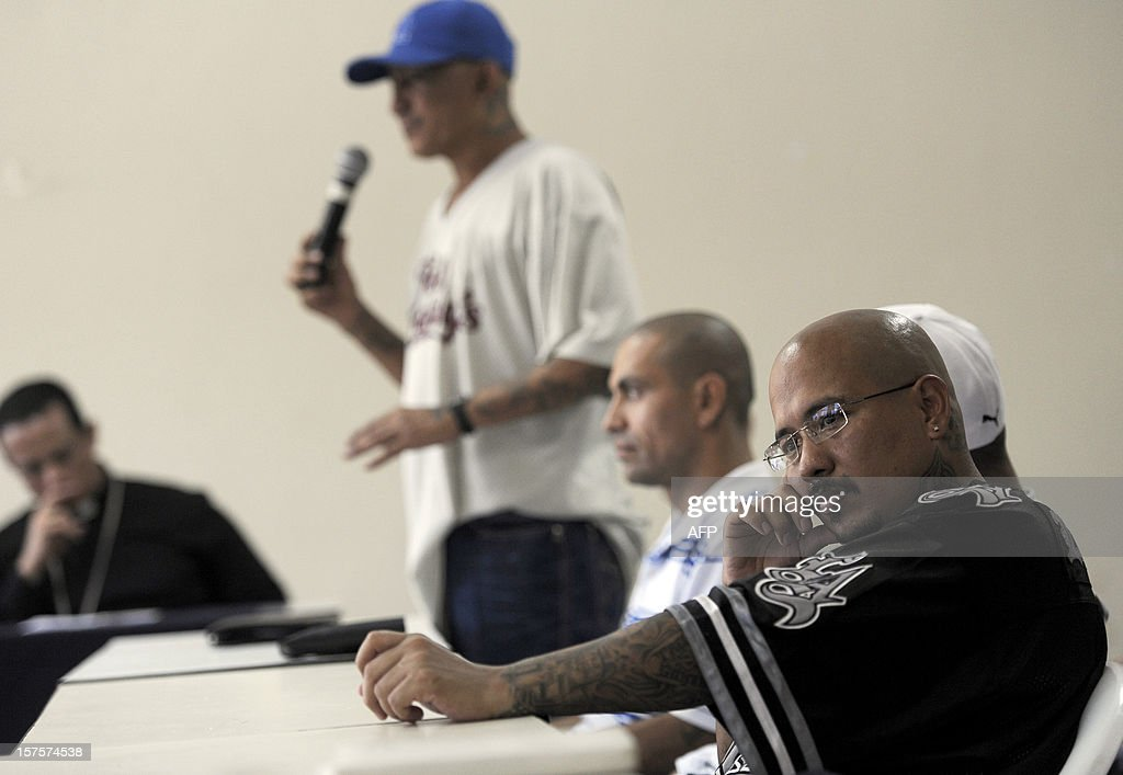 Carlos Alberto Rivas Barahona, a leader of the Mara 18, attends a press conference with both Mara 18 and Mara Salvatrucha members and Salvadorean government mediators, at La Esperanza jail in San Salvador, El Salvador on December 4, 2012. Gang members announced their proposal to create sanctuary territories for gangs as a part of the truce started earlier this year. AFP PHOTO/Jose CABEZAS