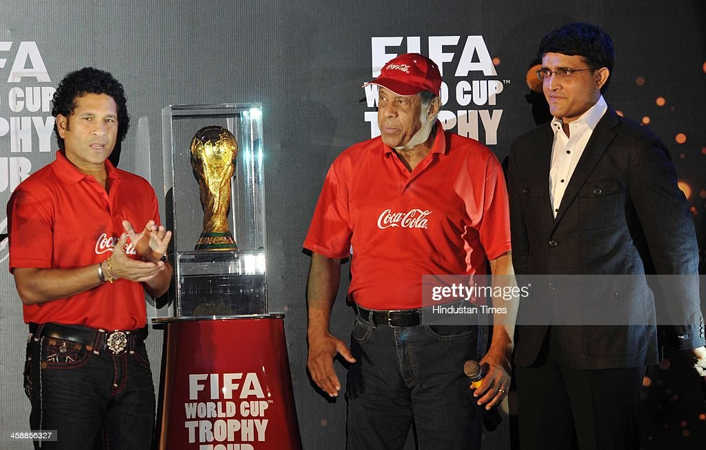 Carlos Alberto Torres, former Brazilian World Cup captain unveils the FIFA World cup Trophy with Indian cricketers <a gi-track='captionPersonalityLinkClicked' href=/galleries/search?phrase=Sachin+Tendulkar&family=editorial&specificpeople=201846 ng-click='$event.stopPropagation()'>Sachin Tendulkar</a> and Saurav Ganguly on December 22, 2013 in kolkata, India. Tendulkar said he was honoured to be present as the FIFA World Cup trophy was unveiled in Kolkata. 'It's a special moment. I hope all the people from Kolkata will enjoy the trophy and respect the rules and regulations.'