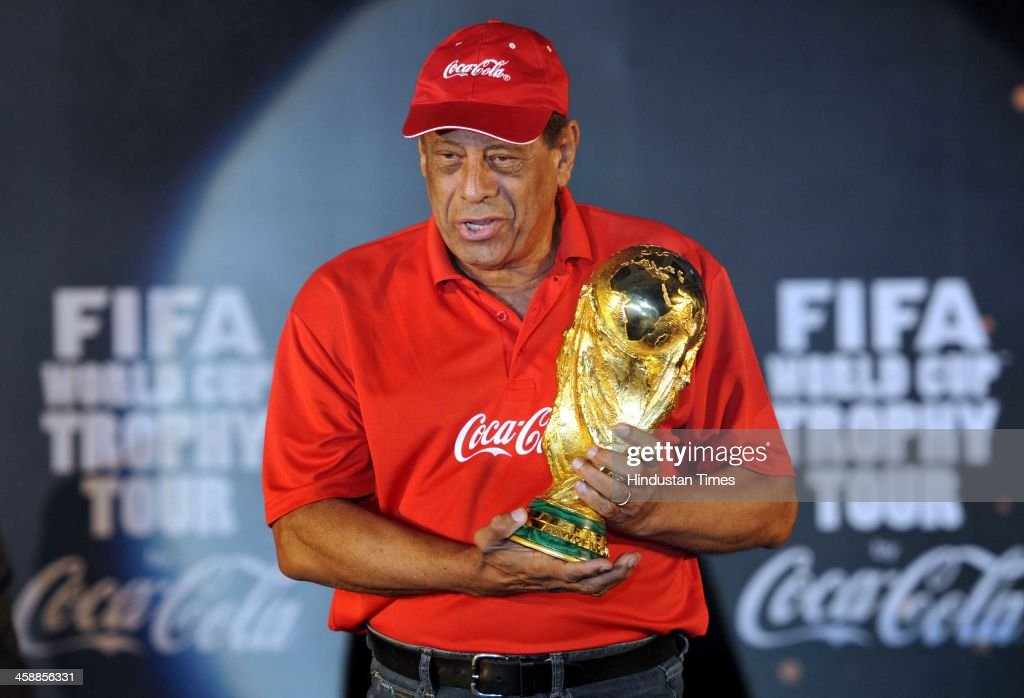Carlos Alberto Torres, former Brazilian World Cup captain unveils the FIFA World cup Trophy on December 22, 2013 in kolkata, India. Tendulkar said he was honoured to be present as the FIFA World Cup trophy was unveiled in Kolkata. 'It's a special moment. I hope all the people from Kolkata will enjoy the trophy and respect the rules and regulations.'