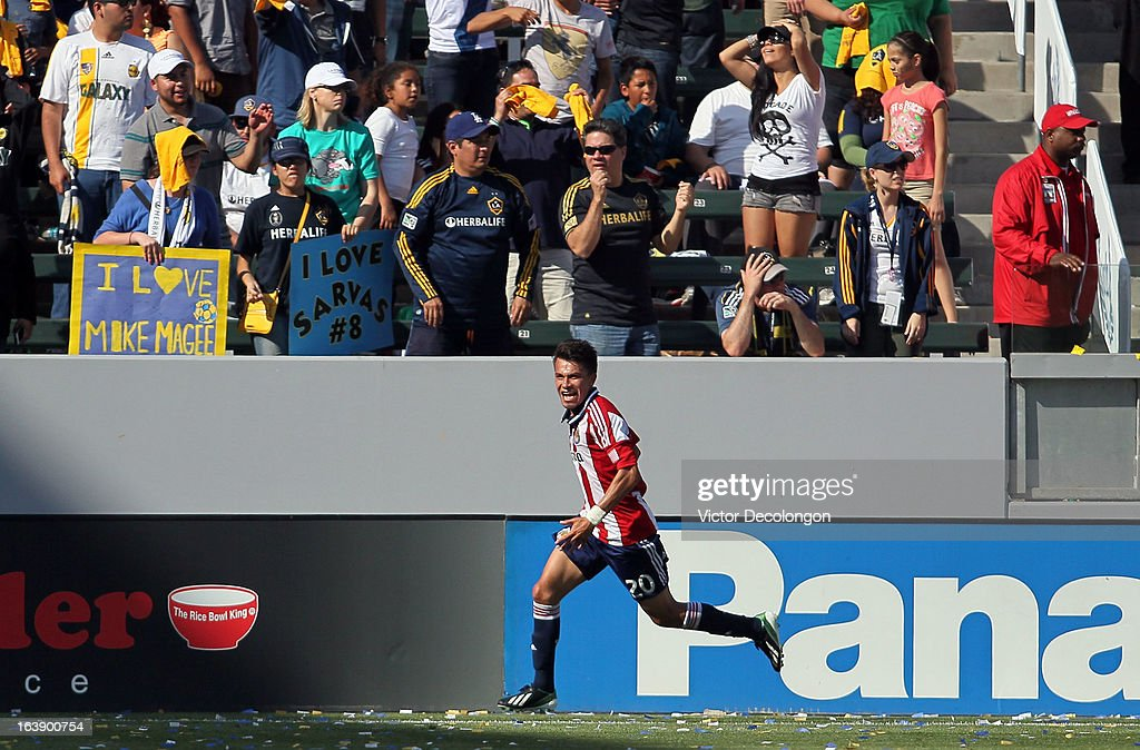 Carlos Alvarez #20 of Chivas USA celebrates after scoring a goal in the 89th minute of play to tie the game during the MLS match against the Los Angeles Galaxy at The Home Depot Center on March 17, 2013 in Carson, California. Chivas USA and the Los Angeles Galaxy played to a 1-1 draw.