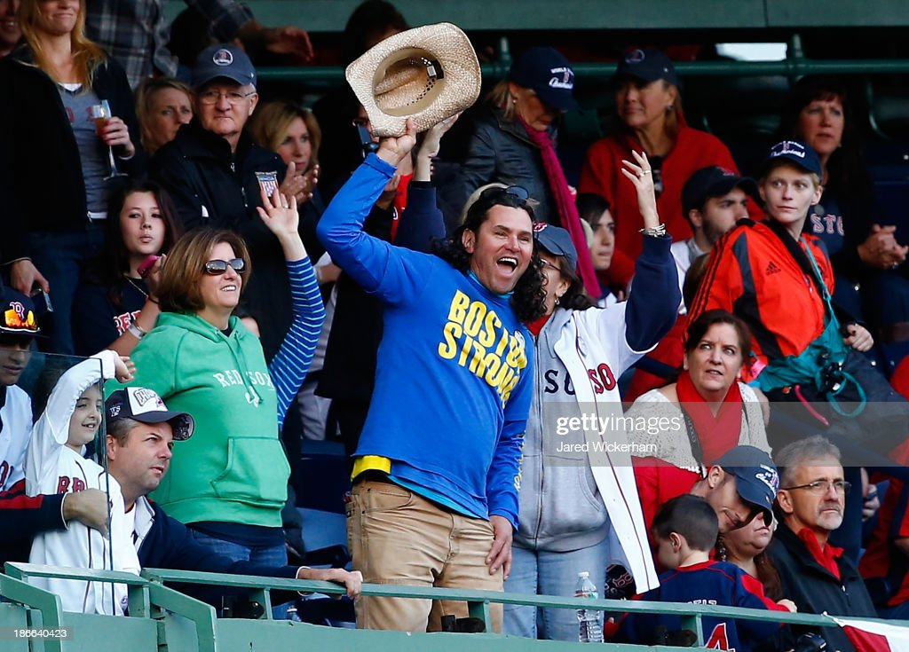 Carlos Arredondo cheers during the World Series victory parade at Fenway Park on November 2, 2013 in Boston, Massachusetts.