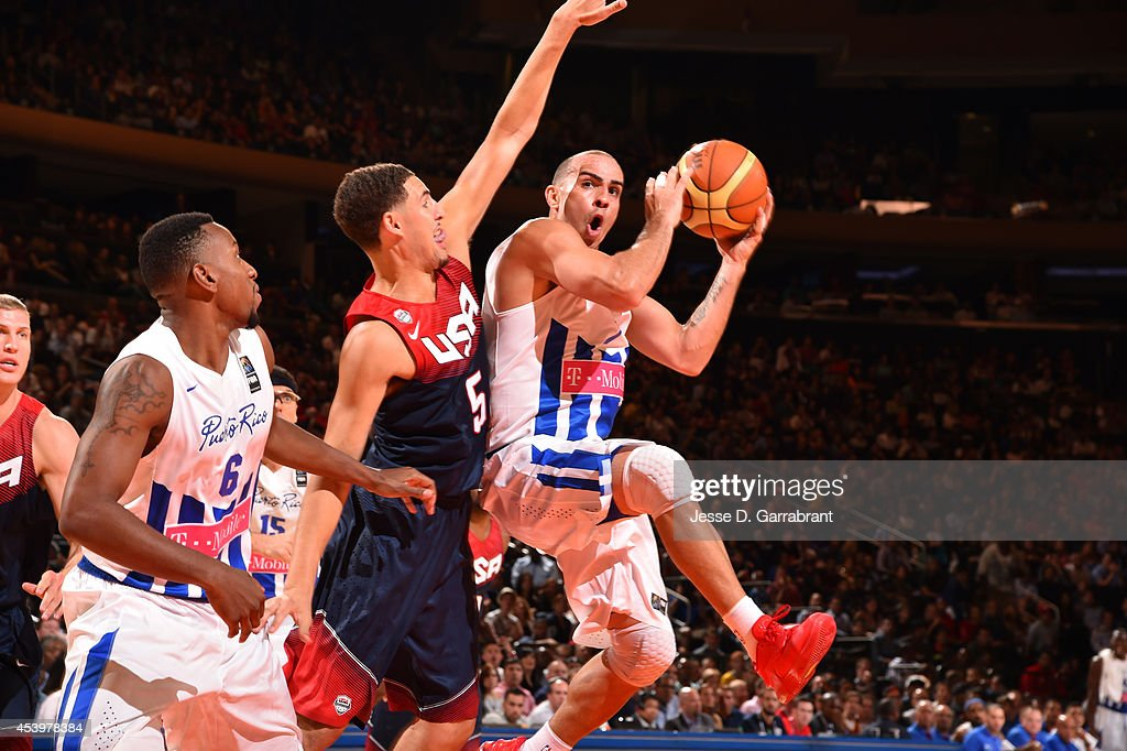 <a gi-track='captionPersonalityLinkClicked' href=/galleries/search?phrase=Carlos+Arroyo&family=editorial&specificpeople=201991 ng-click='$event.stopPropagation()'>Carlos Arroyo</a> #7 of the Puerto Rico National Team passes against <a gi-track='captionPersonalityLinkClicked' href=/galleries/search?phrase=Klay+Thompson&family=editorial&specificpeople=5132325 ng-click='$event.stopPropagation()'>Klay Thompson</a> #5 of the USA Basketball Men's National Team on August 22, 2014 at Madison Square Garden in New York City.