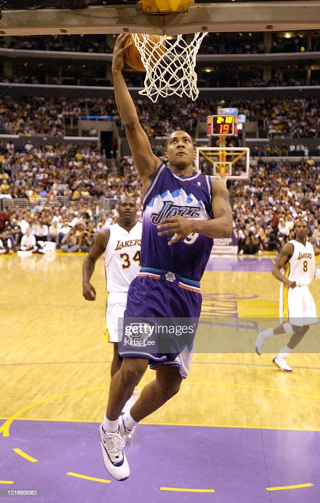 <a gi-track='captionPersonalityLinkClicked' href=/galleries/search?phrase=Carlos+Arroyo&family=editorial&specificpeople=201991 ng-click='$event.stopPropagation()'>Carlos Arroyo</a> of the Utah Jazz goes in for a layup during the game between the Utah Jazz and the Los Angeles Lakers at the Staples Center in Los Angeles, California, on Sunday, March 28, 2004. The Lakers defeated the Jazz 91-84.