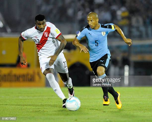 Carlos Ascues of Peru chases Carlos Sanchez of Uruguay during a match between Uruguay and Peru as part of FIFA 2018 World Cup Qualifiers at...