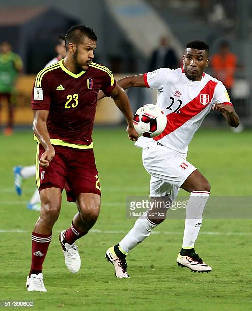 Carlos Ascues of Peru struggles for the ball with Salomon Rondon of Venezuela during a match between Peru and Venezuela as part of FIFA 2018 World...