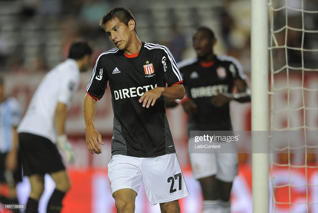 Carlos Auzqui (C) of Estudiantes de La Plata reacts during a match between Estudiantes and Racing as part of the 7th round of the Torneo Final 2013 at Ciudad de La Plata stadium on March 30, 2013 in La Plata, Argentina.