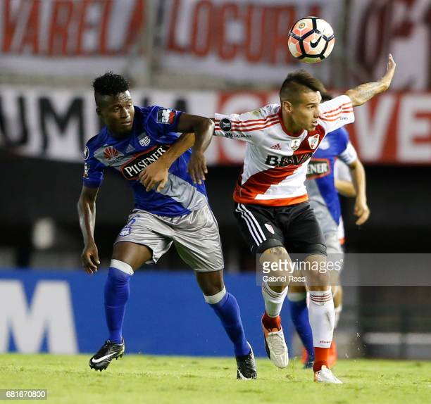 Carlos Auzqui of River Plate and Carlos Moreno of Emelec compete for the ball during a group stage match between River Plate and Emelec as part of...