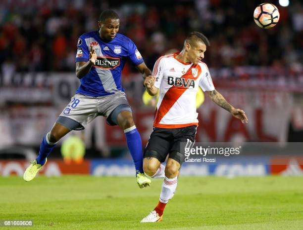 Carlos Auzqui of River Plate and Jordan Andres Jaime of Emelec go for a header during a group stage match between River Plate and Emelec as part of...