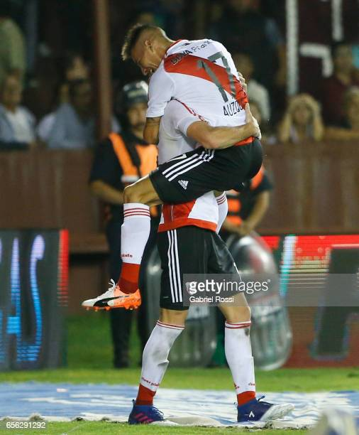 Carlos Auzqui of River Plate celebrates with teammate Lucas Alario after scoring the third goal of his team during a match between Lanus and River...