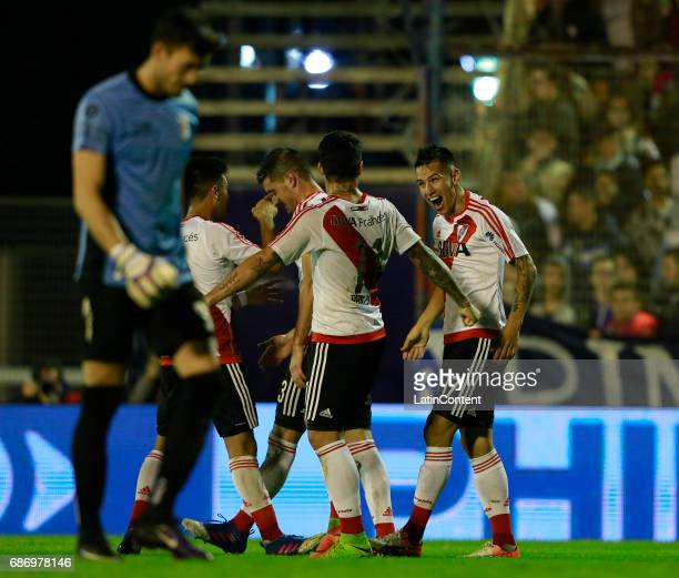 Carlos Auzqui of River Plate celebrates with teammates Sebastian Driussi Lucas Alario and Gonzalo Martinez after scoring the third goal of his team...