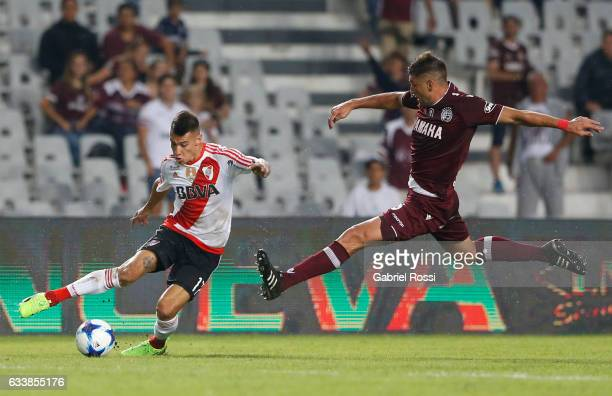Carlos Auzqui of River Plate fights for the ball with Diego Braghieri of Lanus during a match between River Plate and Lanus as part of Supercopa...
