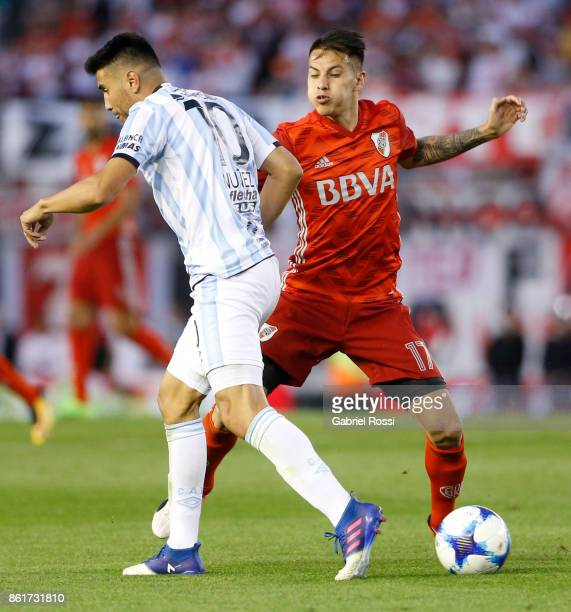 Carlos Auzqui of River Plate fights for the ball with Gervasio Nuñez of Atletico de Tucuman during a match between River Plate and Atletico de...