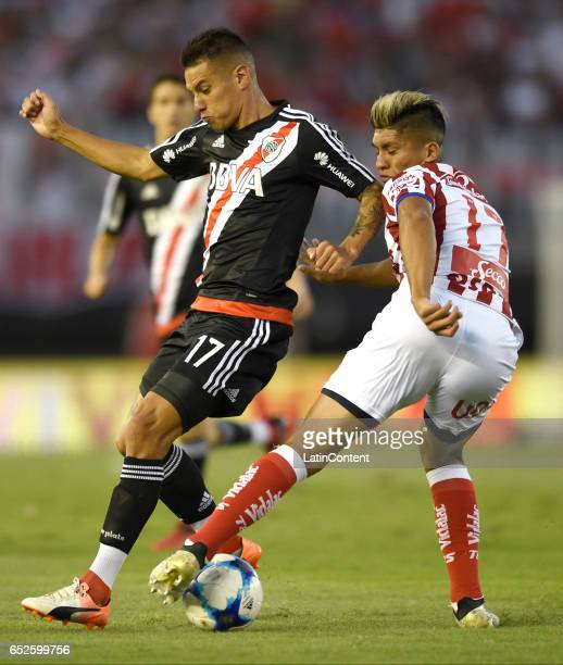 Carlos Auzqui of River Plate fights for the ball with Nahuel Zarate of Union during a match between River Plate and Union as part of Torneo Primera...