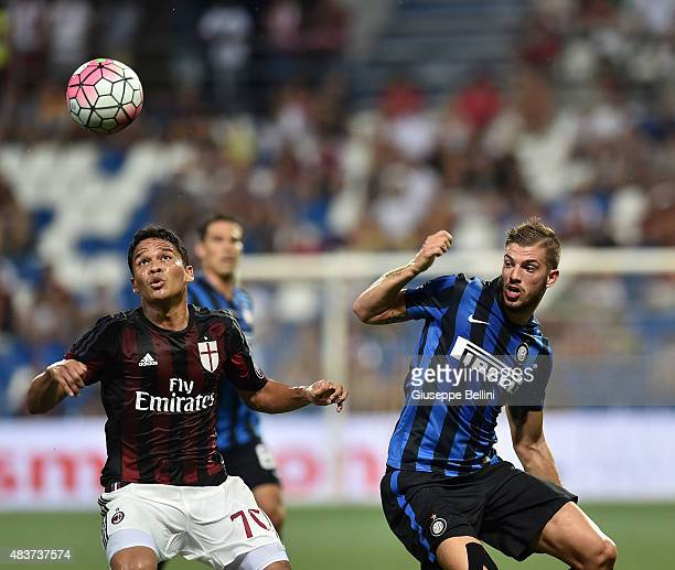 Carlos Bacca Ahumada of Milan and Davide Santon of Inter in action during the TIM preseason tournament match between AC Milan and FC Internazionale...