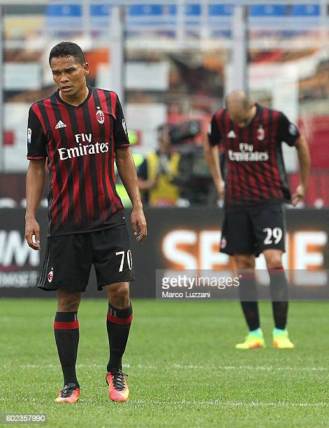 Carlos Bacca and Gabriel Paletta of AC Milan competes for the ball with Duvan Zapata of Udinese Calcioshow their dejection during the Serie A match...