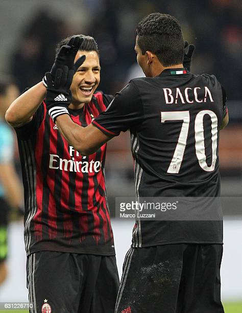 Carlos Bacca and Gianluca Lapadula of AC Milan celebrates a victory at the end of the Serie A match between AC Milan and Cagliari Calcio at Stadio...