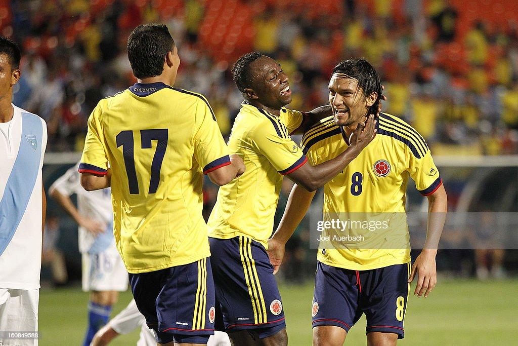 Carlos Bacca #17 and Pablo Armero #7 congratulate Abel Aguilar #8 of Colombia after he scored a second half goal against Guatemala on February 6, 2013 at SunLife Stadium Stadium in Miami Gardens, Florida. Colombia defeated Guatemala 4-1.