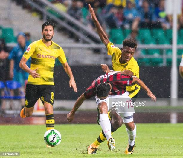 Carlos Bacca of AC Milan and DanAxel Zagadou of Borussia Dortmund compete for the ball during the 2017 International Champions Cup China between AC...