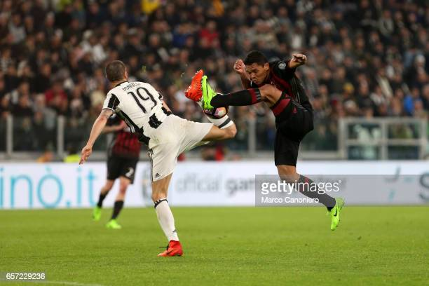 Carlos Bacca of Ac Milan and Leonardo Bonucci of Juventus Fc battle for the ball during the Serie A football match between Juventus FC and Ac Milan...