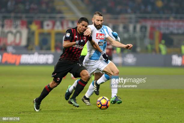 Carlos Bacca of Ac Milan and Lorenzo Tonelli battle for the ball during the Serie A match between AC Milan and SSC Napoli SSC Napoli wins 21 over AC...