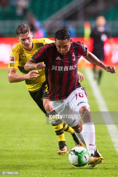 Carlos Bacca of AC Milan and Lukasz Piszczek of Borussia Dortmund compete for the ball during the 2017 International Champions Cup China between AC...