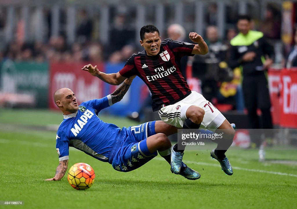 Carlos Bacca of AC Milan (R) and Paolo Cannavaro of US Sassuolo Calcio compete for the ball during the Serie A match between AC Milan and US Sassuolo Calcio at Stadio Giuseppe Meazza on October 25, 2015 in Milan, Italy.