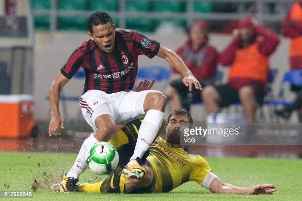 Carlos Bacca of AC Milan and Sokratis Papastathopoulos of Borussia Dortmund compete for the ball during the 2017 International Champions Cup China...