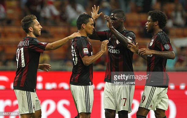 Carlos Bacca of AC Milan ccelebrates with his teammates after scoring the opening goal during the Serie A match between AC Milan and Empoli FC at...